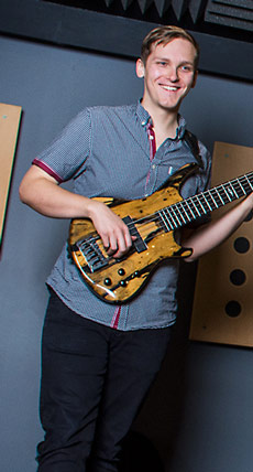 Ben Hearn with a Roscoe bass in the studio