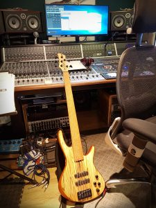 A full photo of my Roscoe Century five string bass in the studio.