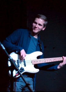 Ben playing bass on stage